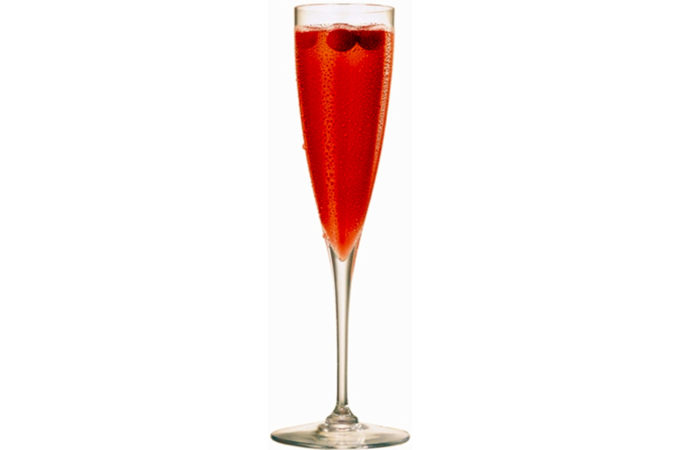 champagne flute with sparking cranberry liquid and floating cranberries