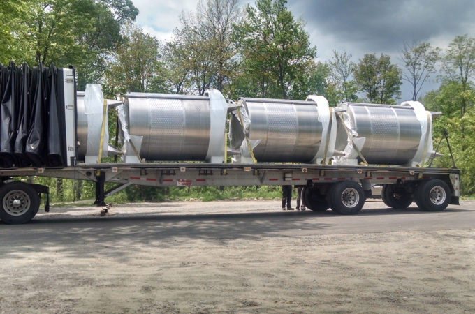 transport truck with four wine tanks on flatbed