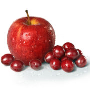 cranberries and apple on white background