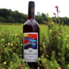 bottle of muskoka lakes cranberry wine standing in cranberries