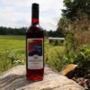 bottle of muskoka lakes cranberry wine in front of a covered bridge