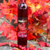 red maple wine in front of red maple leaves