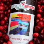 close up of Muskoka Lakes Cranberry Wine emerging from floating cranberries