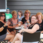 two groups tasting wine on outdoor patio