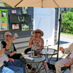 two older couples sampling muskoka lakes wine on the patio