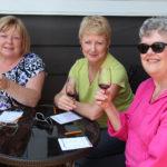 three women sampling wine