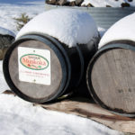 snow covered barrels with Savour Muskoka sign
