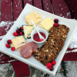 cheese plate on a snowy muskoka chair