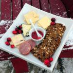 cheese plate on a snowy muskoka chair