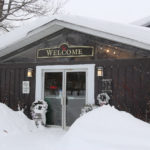 front door of the farm & winery gift store in winter