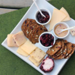 plate with cheese, crackers and preserves