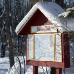 picture of snow covered trail head sign at johnston's cranberry marsh