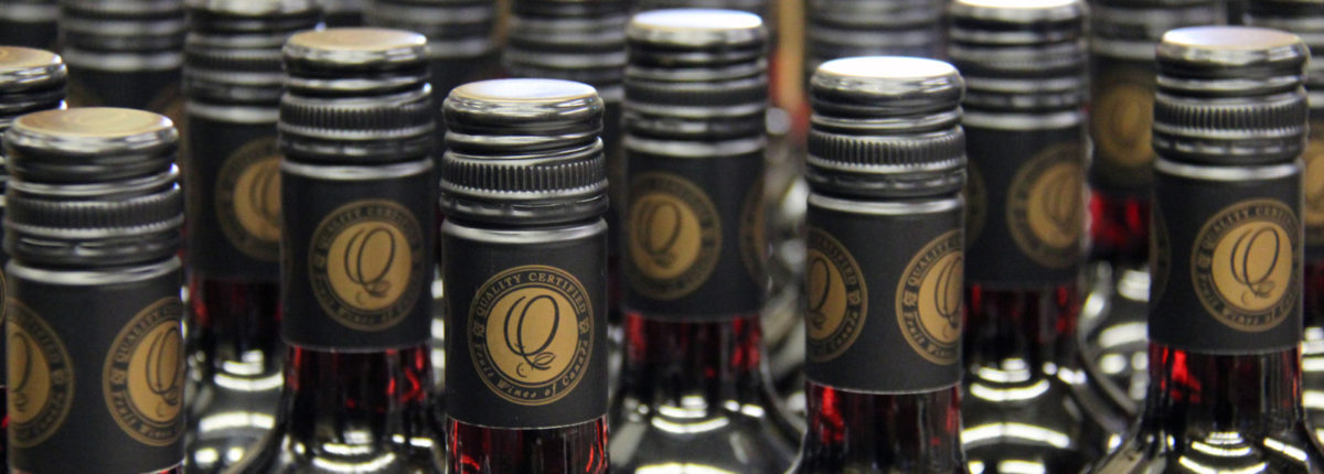 wine bottle tops covered with quality certified capsules