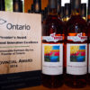 premier's award for agri-food innovation excellence beside Muskoka Lakes White Cranberry Wine