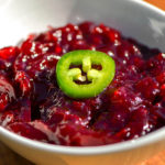 dish of cranberry sauce with hot pepper garnish