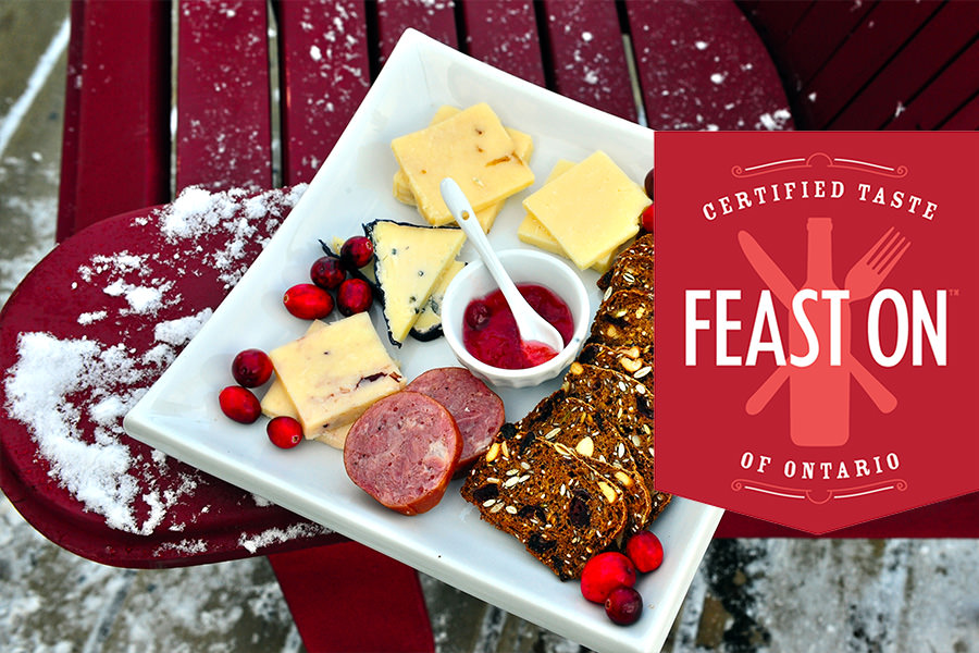 image of cheese plate against snow with feast on logo