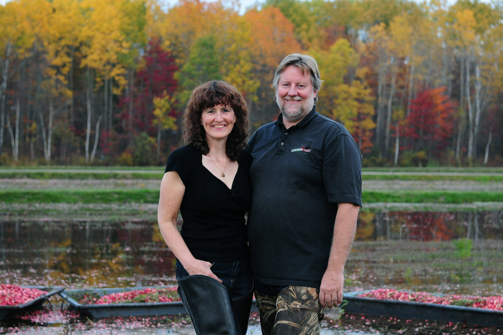 Murray Johnston & Wendy Hogarth in hip waders at harvest time