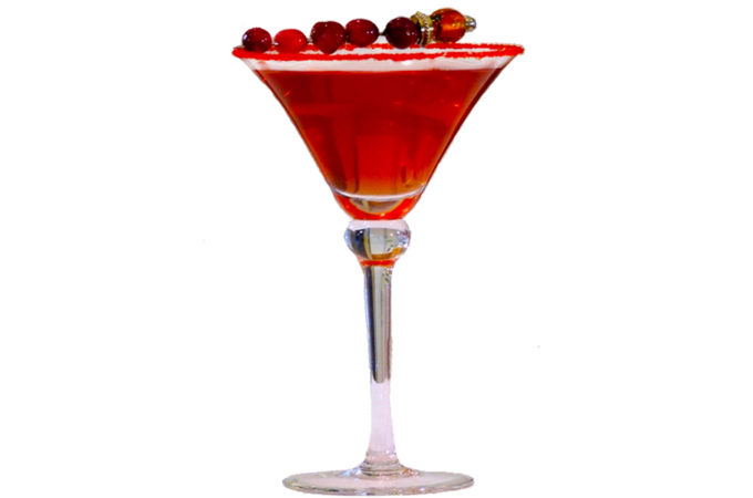 martini glass with cranberry coloured liquid and cranberries on top