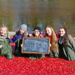 five smiling girls in floating cranberries holding 'my life in 2015' sign