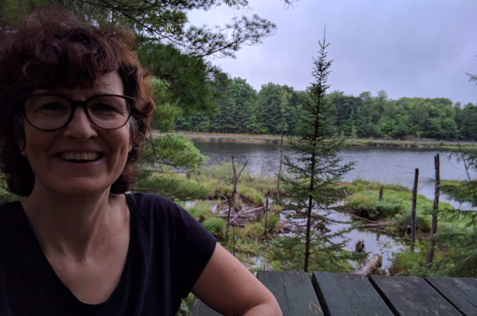 selfie at a picnic table overlooking a lake