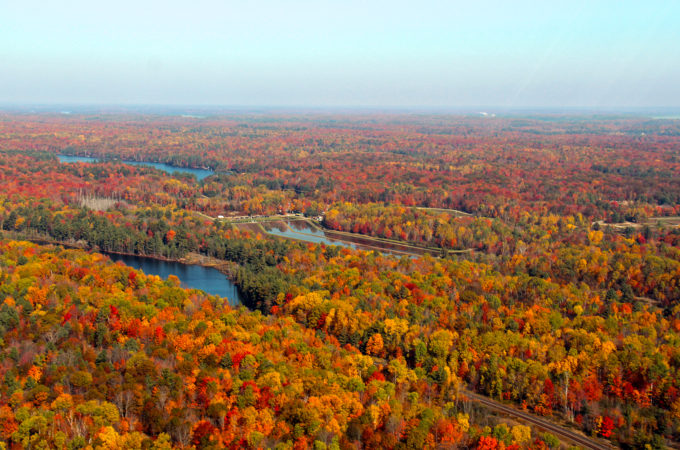 aerial photo of johnston's cranberry marsh with fall coloured forests