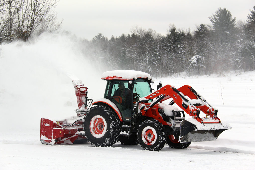 Kubota tractor blowing snow at Johnston's Cranberry Marsh in Bala, Muskoka, Ontario