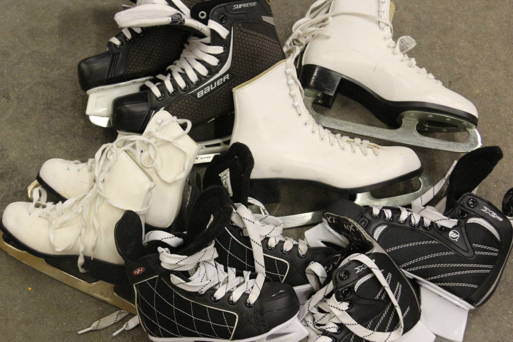 Pairs of men's and ladies' skates for rent at Johnston's Cranberry Marsh in Bala, Muskoka, Ontario