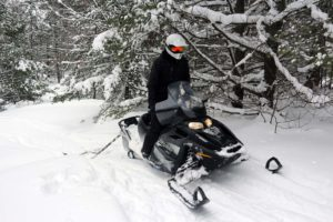 Grooming snowshoe trails with a snowmobile at Johnston's Cranberry Marsh in Bala, Muskoka, Ontario
