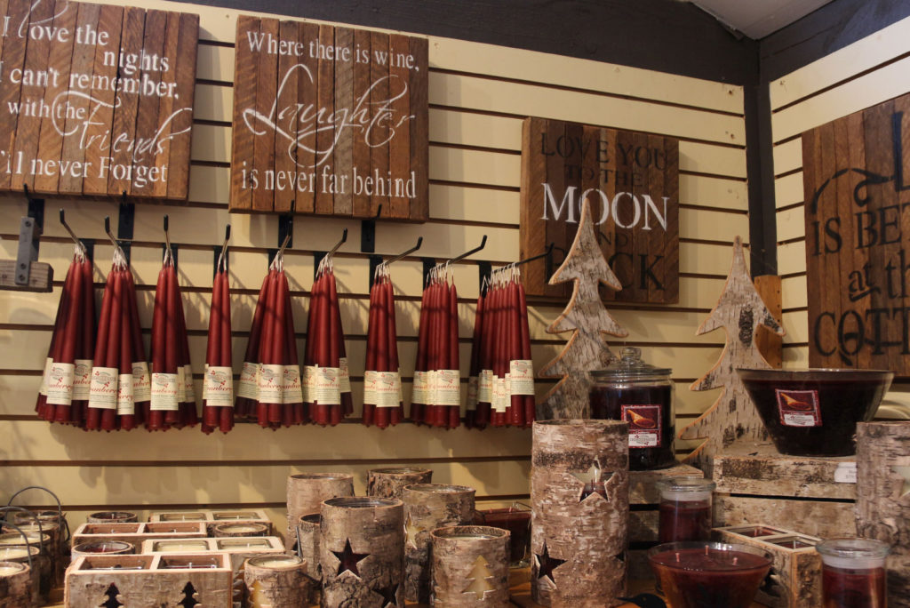 Cranberry candles, birch bark candle holders and cottage signs on store shelves at Johnston's Cranberry Marsh in Bala, Muskoka, Ontario