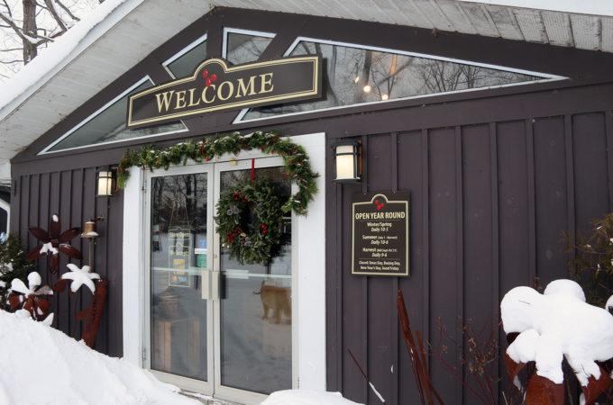 Winter storefront with welcome sign at Johnston's Cranberry Marsh & Muskoka Lakes Winery in Bala, Muskoka, Ontario