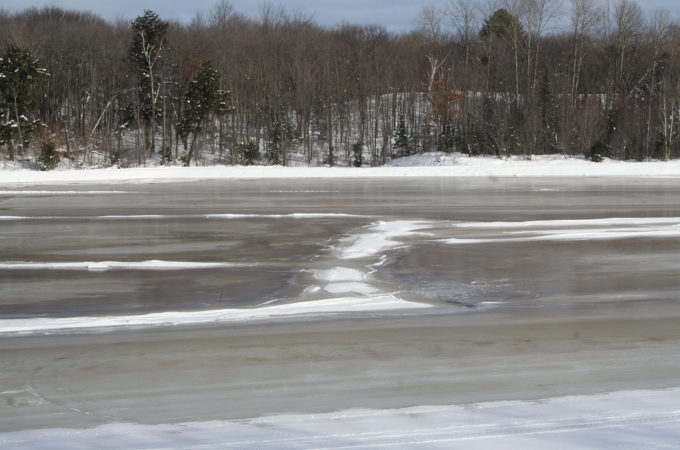 Flooded cranberry beds frozen to ice at Johnston's Cranberry Marsh & Muskoka Lakes Winery