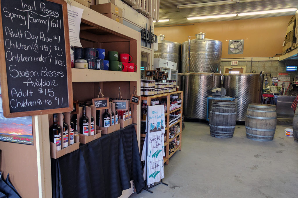 temporary store with wine tanks in background