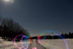 light trails going down an ice trail at night