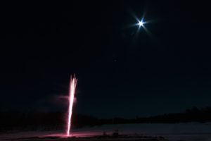 fireworks going off with a full moon