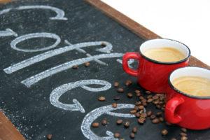 two mugs of coffee on a chalkboard