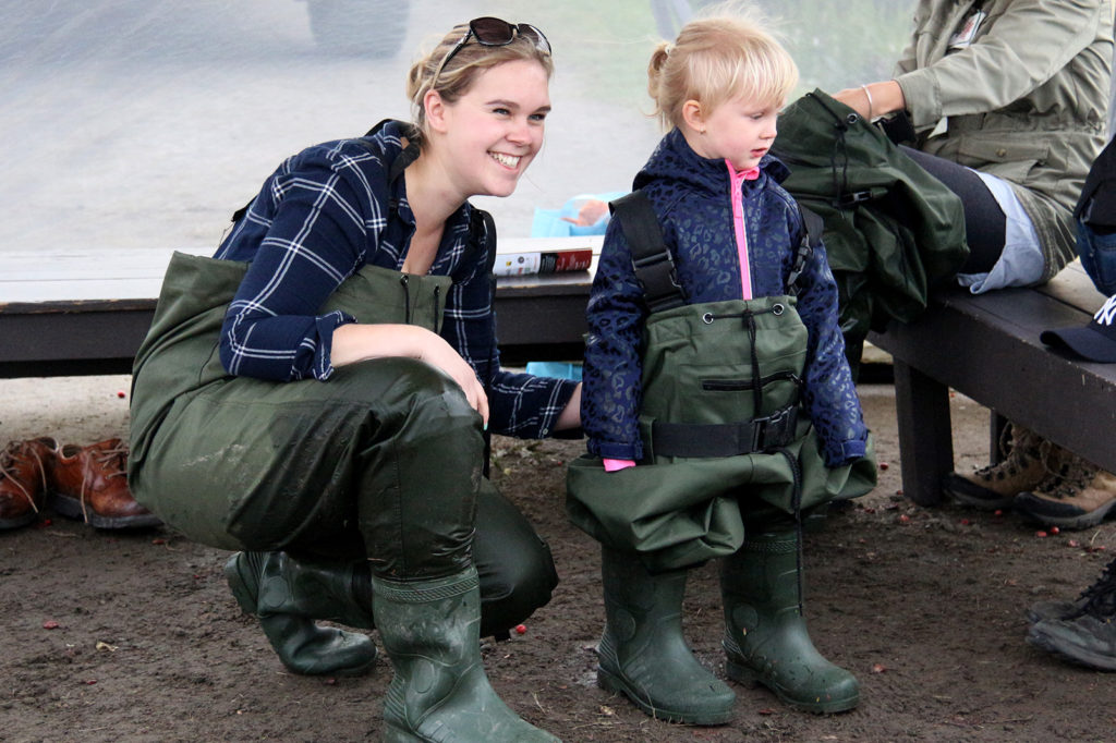 mom and little girl in chest waders