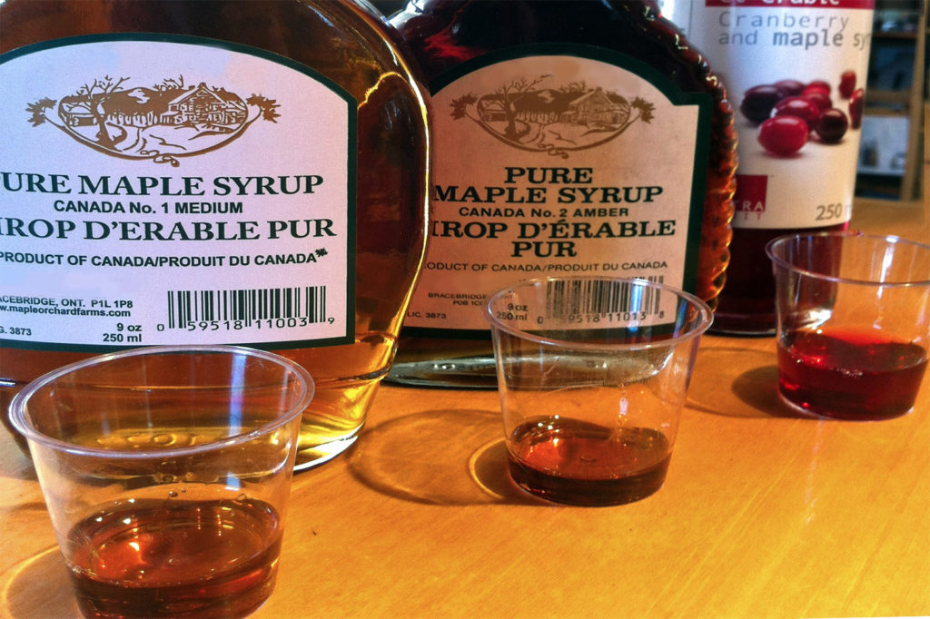 sample cups of maple syrup and cranberry maple syrup