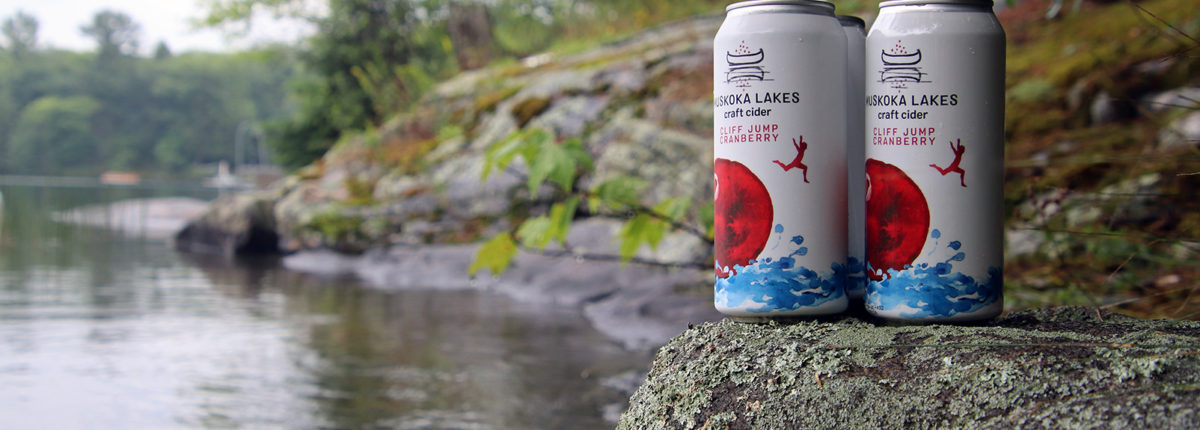 two cans of cliff jump cranberry cider from muskoka lakes