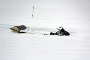 snowmobile in a ditch