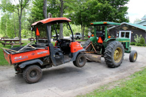 rtv being towed by a tractor