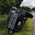 truck sideways in a ditch