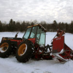 versatile with snowblower sideways in a ditch