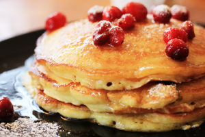 a stack of cranberry pancakes