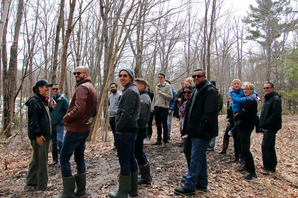 group of people on a sugar bush tour with a guide