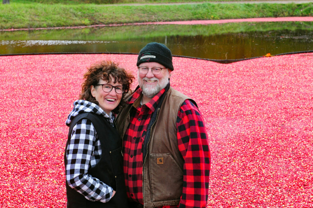 wendy hogarth and murray johnston in the cranberry plunge at muskoka lakes farm and winery