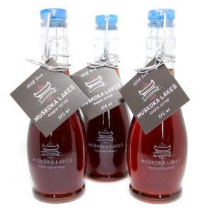 three bottles of muskoka lakes maple syrup