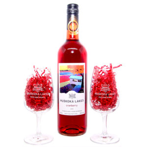 bottle of cranberry wine with two glasses